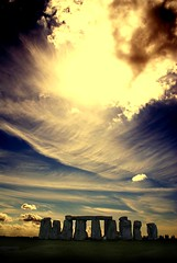 Return to Stonehenge (* Garron Nicholls *) Tags: uk light summer england sky people tourism nature silhouette stone clouds landscape fire ancient community power religion interestingness1 icon lookup stonehenge mysterious fv10 ritual procession i10 landart pagan sevenwonders stonecircle megalith henge i1 garron i500 sevenwonder specsky abigfave