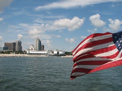 American Flag in Forground, Downtown Milwaukee and Art Museum in Background. - by purpleslog