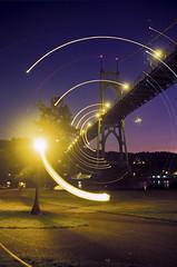 Orbiting the Bridge (Zeb Andrews) Tags: portland dusk nikonfm2 fujivelvia50 stjohnsbridge bluemooncamera zebandrews zebandrewsphotography