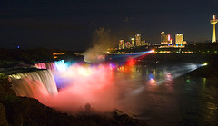 Niagara Falls (Wolfgang Staudt) Tags: travel pink blue red panorama usa ontario canada water colors yellow fog wow river lights niagarafalls boat nikon holidays rocks waves darkness skyscrapers nikond70 availablelight sigma spot spotlight waterfalls horseshoe wilderness reflexions vacancy wolfgang americanfalls spotlights saarbrcken skylontower niagarariver travelphotographie wolfgangstaudt staudt sigmaaf4561020dchsm