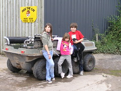 "Kiri, Jo & Liam posing by the ""Cat"" (Dave ®) Tags: kids barn cat pose geotagged farm wheels posing jo liam vehicle atv kiri jojo tyres amphibious argo countrypark offroader offroadvehicle allterrainvehicle courtfarm courtfarmcountrypark eightwheeler geo:lat=51338446 geo:lon=2879378 argoavenger"