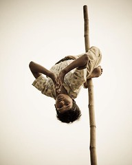 Young Indian acrobat on a really unsteady and stitched together 4m high pole. Flip your phone upside down and you'll probably be surprised by the change of perception, namely his facial expression. (c) Joel Santos. Taken in #jaipur, #rajasthan, #india, wi (Joel Santos - Photography) Tags: instagram young indian acrobat really unsteady stitched together 4m high pole flip your phone upside down you'll probably be surprised by change perception namely his facial expression c joel santos taken jaipur rajasthan india with canon 5d ef24105 f4 is liveforthestory canonportugal canoneurope indiagram portraitmood peopleinfinity