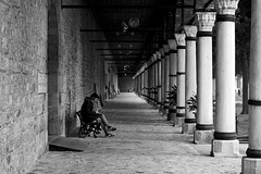 Loneliness in black & white (Daniel Nebreda Lucea) Tags: black white banco negro perspective perspectiva alone solo bank relax relaxing man hombre people gente monochrome monocromatico light luz lights luces shadows sombras pattern patron columns columnas old viejas antiguas viejo antiguo city ciudad street calle urban urbano canon 60d 50mm stone piedra composition composicion istanbul estambul turkey turquia sit sentar sentado life vida thinking pensando europe