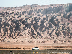 On the road to Turfan (10b travelling / Carsten ten Brink) Tags: 10btravelling 2017 asia asian asien carstentenbrink china chine chinese iptcbasic prc peoplesrepublicofchina silkroad tarim tulufan turfan turpan xinjiang basin erosion geology hills landscape mountains tenbrink 中华人民共和国 中国 吐魯番