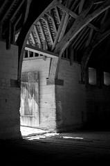 Tithe Barn, Bradford-on-Avon (Velosnapper) Tags: bradfordonavon barn blackandwhite light door doorway beams wood old somerset