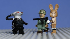 Confrontation (N.the.Kudzu) Tags: tabletop lego minifigures alien soldier bunny suit canondslr canon50mmf18 flash girl