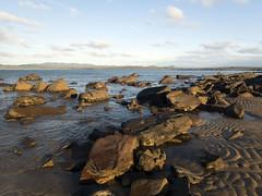 Rocks on the shoreline (Baractus) Tags: coastline shore rocks john oates hawleybeach tasmania australia inala nature tours