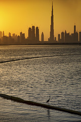 Just a moment .. (Almsaeed) Tags: burj khalifa sunset moment sea water lake dubai curve towers buildings yellow colors lights shadow