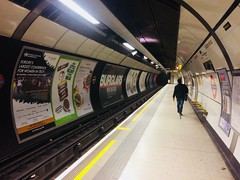 """Alone. (Bennydorm) Tags: """"somerstown"""" """"northernline"""" city tunnel solitary london iphone5s may passenger traveller person sole only alone transit travel platform """"londonbridge"""" station tube underground tfl"""