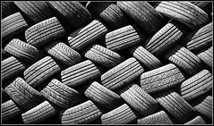 Getting tyred............... (Jason 87030) Tags: tyres tread grip rubber scrap bw bbw blackandwhite frame mono light noir blanc michelin wheels cars parts daventry wall pile composition shot image
