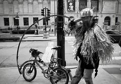 Flip Bike Travis, reporting for duty outside the Art Institute of Chicago. (noir imp) Tags: stuntman stunts moondog ricohgr costume silver sparkles helmet streetperformers streetphotography biker artinstituteofchicago chicago flipbiketravis