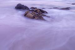 L64 (jennypowisphotography) Tags: pinks white rocks shore foam slowshutterspeed lowlight sand tidal coastline pastelcolours