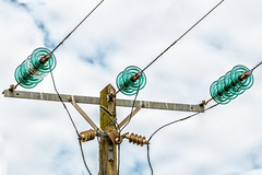 Insulators (Mark Wasteney) Tags: telegraphtuesday htt powerlines powerpole electric energy grid insulators glass wood pole lines