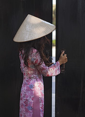 Vietnamese Ao Dai (Sharpshooter Alex) Tags: ao dai vietnam vietnamese conical hat traditional dress clothing door opening woman female