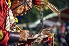 A judge taking notes (PeterThoeny) Tags: stanford stanforduniversity california siliconvalley sanfranciscobay sanfranciscobayarea southbay powwow stanfordpowwow festival competition dance costume americanindian portrait person judge pen paper penandpaper feather light night sony a7 a7ii a7mii alpha7mii ilce7m2 fullframe vintagelens dreamlens canon50mmf095 canon 1xp raw photomatix hdr qualityhdr qualityhdrphotography fav100