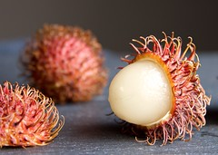 Rambutan, The Hairy Lychee Fruit (The Good Brat) Tags: fruit food table slate stilllife hairy lychee rambutan red tropical grocery produce costarica