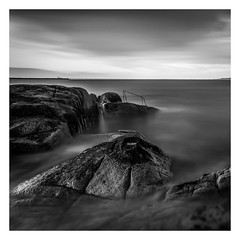 Evenings End (Minibert93) Tags: blackwhite bigstopper longexposure dunlaoghaire 40ft railing rocks coast seascape sunset clouds sky ireland canon nisi slowshutter