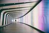 Passenger (ShrubMonkey (Julian Heritage)) Tags: lightlab lighttunnel kingscross stpancras stations underground tunnel led lights candid person streetphotography city urban london walkway lightwall