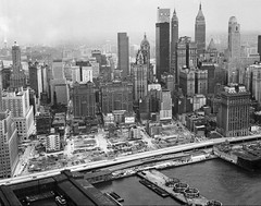 """The future site of the real World Trade Center. Most of the small """"radio row"""" stores were already demolished and only empty square blocks remained. The ornate Singer Building in the center distance. New York. March 1967 (wavz13) Tags: newyorkphotographs newyorkphotos urbanphotography urbanphotos urbanscenes cityphotography cityphotos newyorkphotography manhattanphotography manhattanskyline newyorkskyline newyorkskyscrapers manhattanskyscrapers urbanlife newyorklife manhattanlife lowermanhattan lowerwestside city oldbuildings vintagebuildings modernbuildings modernism urbanmodernism oldphotographs oldphotos 1960sphotographs 1960sphotos oldphotography 1960sphotography oldnewyorkphotography oldnewyorkphotos vintagenewyork vintagemanhattan oldworldtradecenter vintageworldtradecenter twintowers originalworldtradecenter vintagetribeca oldtribeca vintageconstruction oldconstruction oldfactories vintagefactories 19thcenturybuildings newyorkskyscapers manhattanskyscapers manhattanhistory newyorkhistory 1960smanhattan 1960snewyork oldnewyork oldmanhattan"""