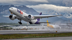 The World on Time, Airborne (N1_Photography) Tags: fedex boeing 777 freighter air cargo mountain alaska anchorage cloud rain anc panc federal express the world time ge ge90 general electric turbine engine wing aviation