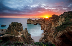 Sunset over the Algarve (mickreynolds) Tags: 2018 algarve alvor april2018 family nx500 portugal samyang12mm seastack seascape heather sea gull beach cliffs