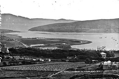 The Kingdom in all its glory! (National Library of Ireland on The Commons) Tags: robertfrench williamlawrence lawrencecollection lawrencephotographicstudio thelawrencephotographcollection glassnegative nationallibraryofireland dingle dingleharbour kerry countykerry ireland sea land mountains boats cottages houses farrannakillahouse dinglepeninsula stmaryschurchdingle traleeanddinglelightrailway wreck hussey'sfolly coastguardstation dingleskellighotel hayfield workhouse