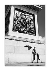 Pigeon Feeder (Dave Fieldhouse Photography) Tags: grabshot fun streetphotography street london landmark piccadilly picaddillycircus nelsonscolumn people pigeon candid story history blackandwhite mono monochrome fujifilm fujixpro2 fujinon35mmf2 fuji wwwdavefieldhousephotographycom project daytime streetwalk casual moment city citycentre life wildlife bird