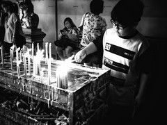 Jakarta (-Faisal Aljunied - !!) Tags: candles praying temple 17mm18 blackandwhitestreet olympusomdem5 indonesia jakarta faisalaljunied