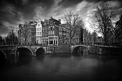 Amsterdam Famous Canal B/W (l.cutolo) Tags: sharp shy reflections holland tourism canal amsterdam sony world water monochrome blackandwhite lucacutolo drama ams architecture museum cityscape sunset citylife colours tlp city europe ononeraw monument canalboat worldtrekker citycentre ngc art sonyepz1650mmf3556oss