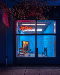 Antiques and Love Letters (llabe) Tags: blue storefront nightlights night street tacoma washington nikon d750