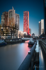 Nothing Attracts Attention Like A Red Dress I (Alec Lux) Tags: rotterdam apple architecture building canal city cityscape design holland landscape landscapephotography longexposure longexposurephotography netherlands red redapple reflection river skyline skyscraper structure urban water zuidholland nl