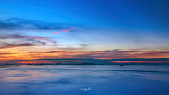An evening by the Sea (Anirban.243) Tags: sky blue sea longexposure pier dock harbour boat clouds mountain thailand asia red yellow canon lightroom dramatic horizon sunset ngc