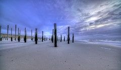 Afraid of the water. (Alex-de-Haas) Tags: 11mm adobe d850 dutch hdr holland irix lightroom nederland nederlands netherlands nikon noordholland noordzee northsea petten pettenaanzee photomatix photomatixpro beach beachscape exposure hemel landscape landschap longexposure lucht palen pillars poles sand sea skies sky steunpijler steunpijlers steunpilaar steunpilaren strand sundown sunset supportpillars wind winter zand zee zonsondergang