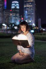 Reading (mikemikecat) Tags: tamarpark portrait bokeh nightview night