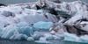Jökulsárlón (Fret Spider) Tags: jökulsárlón glacier ice water wind weather cloud sky telephoto blue silt canoneos5dmarkiv canonef70200mmf28lisiiusm iceland vatnajökullnationalpark tongue snout nature outdoors geology wife vacation relax recuperate recharge iceberg