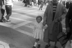 1959-1 10 (ndpa / s. lundeen, archivist) Tags: nick dewolf nickdewolf blackwhite photographbynickdewolf bw 1959 1950s film 35mm monochrome blackandwhite italy venice europe people pedestrians child girl holdinghands woman dress purse handbag men women piazza square piazzasanmarco coat motherandchild womanandchild italian