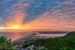 Chesil explosion (Chris Jones www.chrisjonesphotographer.uk) Tags: colour explosion nature natural portland weymouth buildings 2012 academy sailing olympic wwwchrisjonesphotographeruk coastline coast jurassic sunset ocean seascape sea photographer jones chris uk england west south dorset bank beach chesil