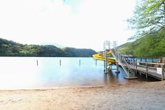 Sliding in a bright lake (phericpascolo) Tags: trentino levico scivolo slide yellow ndfilter neutraldensity italia italy trento