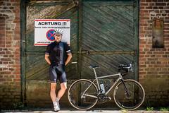 Riding the Bike - Sporting the Kit (Torsten Frank) Tags: backsteinmauerwerk bergischesland corsag dahlhausen deutschland erc1400spline47 eingang fahrrad familie jguillem kleidung kurbel laufrad leistungsmesskurbel mauer mauerwerk nordrheinwestfalen orient quarq quarqdzerosramred radhose redetap redetaphrd reifen rennrad sram schaltgruppe selbstportrait sportbekleidung sportful tor trikot vittoria dtswiss bike bicycle cyclist cycling