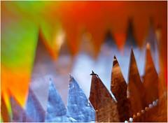 Rough ! (jesse1dog) Tags: macromondays jagged pentax110 70mm kitchen foil glitzybag scissors aluminium rainbowcolours extensiontube gm1 kitchenfoil abstract tabletop bokah