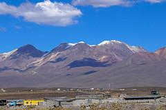 The volcano Chachani / Вулкан Чачани (Vladimir Zhdanov) Tags: travel peru andes altiplano sky cloud mountains snow landscape road building chachani volcano