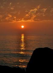 Sun Rising over Lake Michigan with a boat on the Horizon (marymorano) Tags: sun sunrise lakes greatlakes reflections lakemichigan water morning dawn goldenhour glowing horizon