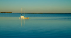 Serenity (judi may) Tags: wellfleet capecod massachusetts newengland goldenhour boat water ocean sea calm serene serenity usa minimal simplicity tranquil tranquility reflection sky light goldenlight golden canon7d boats landscape seascape less lessismore negativespace