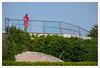 Di rosso vestito. (Outlaw Pete 65) Tags: ritratti portraits persone people uomo man rosso red verde green piscina swimmingpool fujixe3 fujinon55200mm cavallinotreporti veneto italia