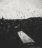 Raindrops and train (ZinckPhotography) Tags: berlin train rain rainy raining railroad raindrops sky skyline cloud clouds atmosphere dark weather bvg trainstation city cityphotography photography photo panasonic lumix microfourthirds minimalistic closeup window windy