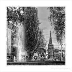Umbrellas needed (PAUL YORKE-DUNNE) Tags: city plymouth mono bw buildings fountain church