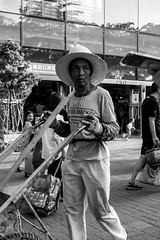 Brickie (cdawson77) Tags: china street people bw blackwhite monochrome mono construction wheelbarrow cart chris dawson olympus microfourthirds mft m43 panasonic 25mmf17 lumixg25f17 pen epl3