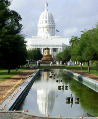 From Victoria park (M.K.Muruganandan) Tags: cmc colombo victoriapark pond tress buddhastatue reflection flags