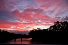 Sunset at Tocumwal on the Murray River (adamsgc1) Tags: murrayriver tocumwal nsw newsouthwales border victoria sunset bridge clouds red