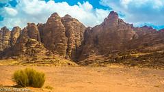 Wadi Rum (Tom Warneke) Tags: sand colours ruins jordan middleeast sky mountains heritage environment wonder camels desert wadirum
